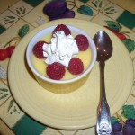 Creamy pudding with berries and cream